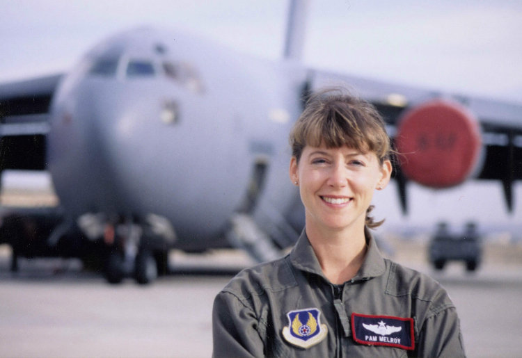 Pamela Melroy smiling onsite in her job. This photo was taken when Pam Graduated as a US Air Force test pilot in 1991