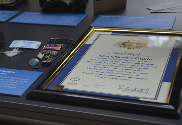 Queen's guide certificate and badges